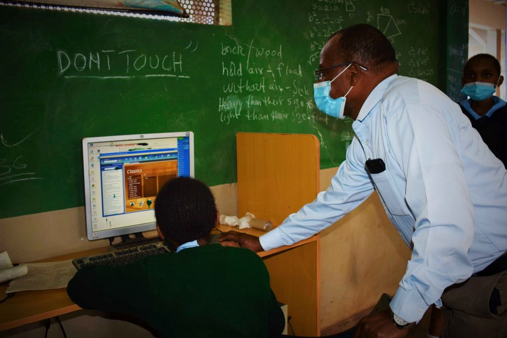 A student being guided through the use of a computer application.
